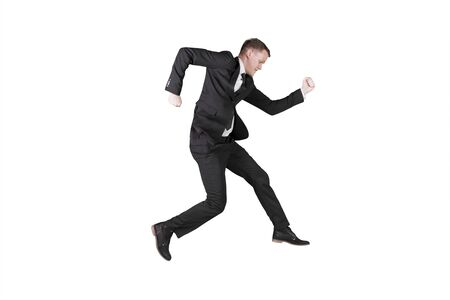 American businessman wearing formal suit and sprinting forward in the studio, isolated on white background