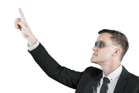 Close up of American male manager wearing futuristic glasses while touching on the transparent screen, isolated on white background Stockfoto