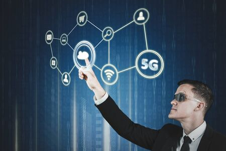 Fast data transfer concept. Caucasian businessman wearing futuristic glasses while touching virtual screen