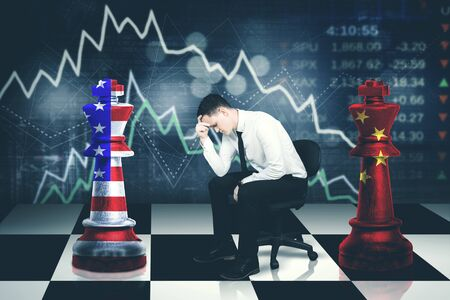 Image of young businessman looks stressed with trade war between USA and China