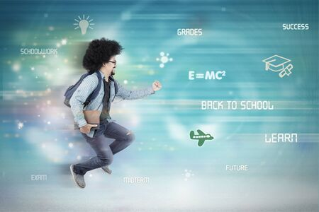 Picture of Afro male college student carrying a book while running fast inside binary code Stock Photo
