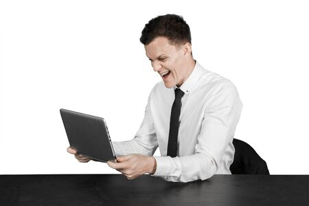 Caucasian businessman expressing happy while holding a laptop in the studio, isolated on white background