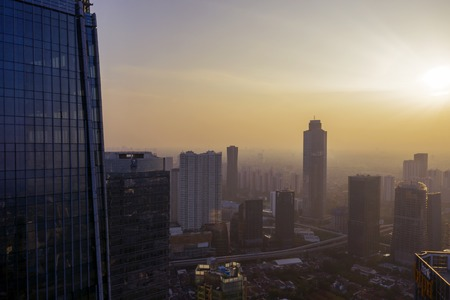 JAKARTA - Indonesia. June 25, 2019: Jakarta cityscape with high buildings with misty morning at dawn time
