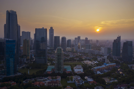 JAKARTA - Indonesia. June 25, 2019: Aerial view of high buildings in Jakarta city at sunset time 에디토리얼
