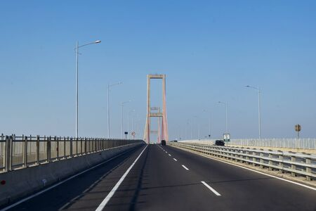 Beautiful longest Suramadu bridge under blue sky in East Java, Indonesia