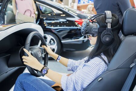 Tangerang - Indonesia. July 24, 2019: Image of young woman testing Honda Sensing at event of Gaikindo Indonesia International Auto Show Stock Photo