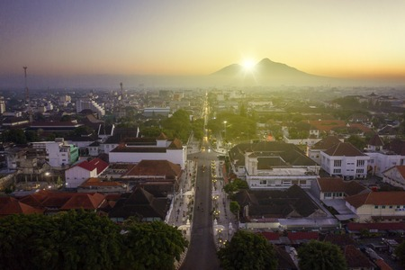 Yogyakarta - Indonesia. July 18, 2019: Beautiful sunrise at zero point kilometer of Yogyakarta city with Mahameru mountain background