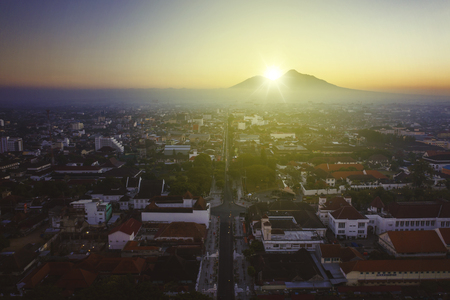 Yogyakarta - Indonesia. July 18, 2019: Aerial view of zero point kilometer of Yogyakarta city with Mahameru mountain background at sunrise time