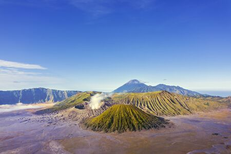 Aerial view of Bromo mountain under blue sky at morning time in East Java, Indonesia