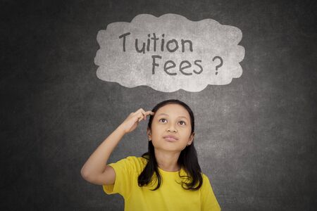 Picture of thinking schoolgirl looking at question of tuition fees on the cloud bubble