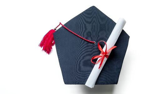 Top view of graduation hats and diploma, isolated on white background Stok Fotoğraf