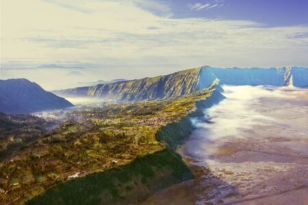 Beautiful aerial view of Tengger Caldera on mount Bromo at misty morning in East Java, Indonesia