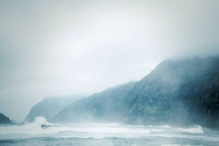 Exotic scenery of Papuma beach with mist at morning time in Jember at East Java, Indonesia Stok Fotoğraf
