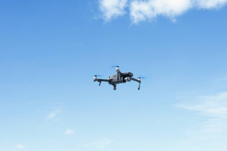 Image of black drone with high resolution digital camera in the blue sky Stok Fotoğraf