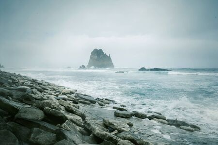 Beautiful scenery of Papuma coastline at misty morning in Jember at East Java, Indonesia