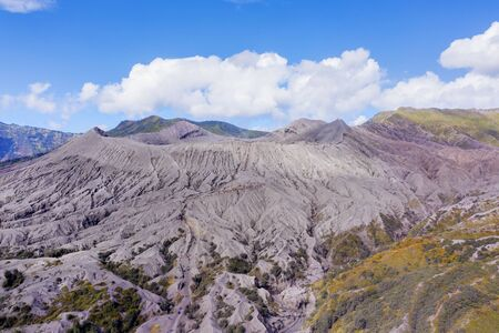 Beautiful scenery of Mount Bromo volcano crater under blue sky in East Java, Indonesia