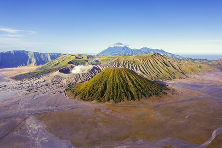 Beautiful scenery of Mount Bromo volcano peak with volcanic gas under blue sky in East Java, Indonesia Stok Fotoğraf