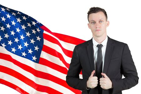 Caucasian businessman looks confident while standing with an American flag in the studio Stok Fotoğraf