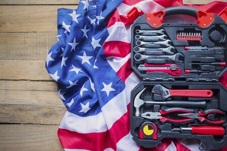 Labor Day concept. Top view of toolbox with American flag on the wooden table