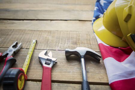 Close up of construction tools on the wooden table with American flag Stok Fotoğraf