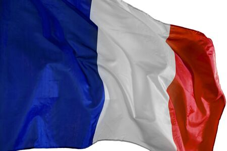 Close up of French flag blowing in the wind, isolated on white