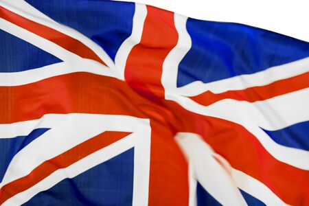 Close up of United Kingdom flag waving in the wind, isolated on white