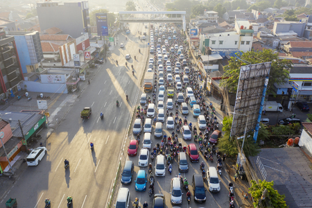 JAKARTA - Indonesia. August 08, 2019: Drone view of traffic jam with crowded cars and motorcycles on the road in Jakarta city