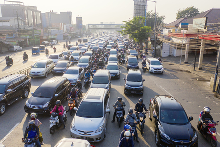 JAKARTA - Indonesia. August 08, 2019: Drone view of hectic traffic with crowded cars and motorcycles on the road in Jakarta city