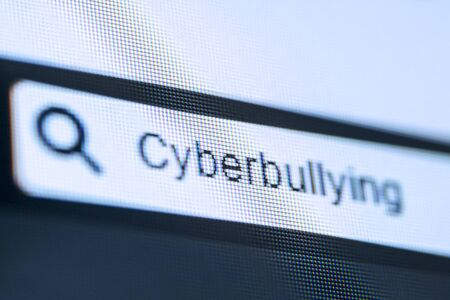 Concept of search engine. Close up of search bar with typed Cyberbullying word on the computer screen
