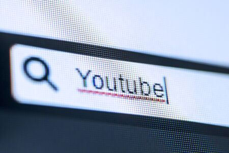Close up of computer screen with typed YouTube word on the browser tab