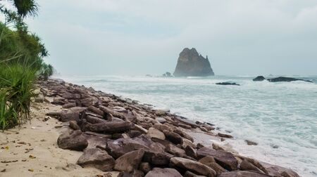 Exotic scenery of Papuma coastline at misty morning in Jember at East Java, Indonesia 写真素材