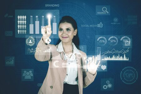 Portrait of pretty businesswoman working with financial chart on virtual screen