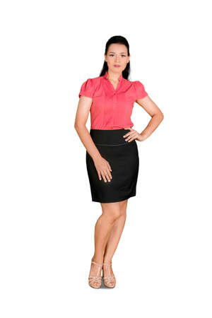 Full length of business woman standing and posing with arms on her waist in the studio. Isolated on white background