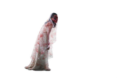 Halloween horror concept. Portrait of scary female ghost with bloody bride gown and walking in the studio