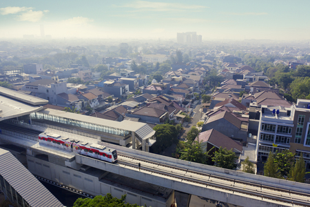 JAKARTA - Indonesia. September 18, 2019: Aerial view of Jakarta MRT moving on the elevated tracks in Jakarta city