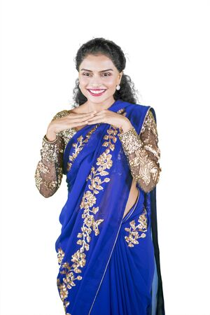 Portrait of beautiful woman looks awkward while wearing a blue saree clothes in the studio Stock Photo