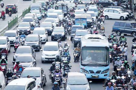 JAKARTA - Indonesia. September 25, 2019: Aerial view of cars and motorcycles on hectic highway in Jakarta city