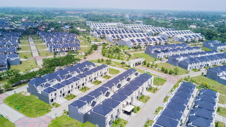 JAKARTA - Indonesia. October 01, 2019: Aerial view of new residential houses surrounded by green garden Editorial