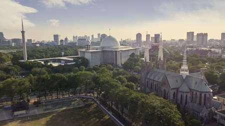 JAKARTA - Indonesia. October 11, 2019: Aerial view of Cathedral Church and Istiqlal mosque in Jakarta city, Indonesia
