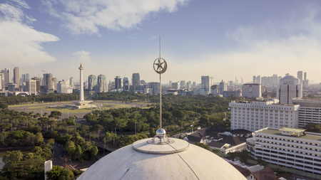JAKARTA - Indonesia. October 11, 2019: Beautiful aerial view of Istiqlal mosque with National Monument in the Jakarta city at afternoon time