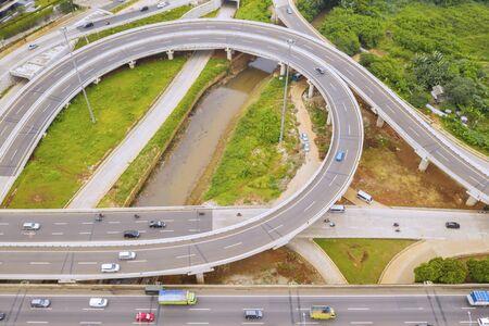 Top down view of vehicles passing through on Depok Antasari toll road interchange 写真素材 - 132390825