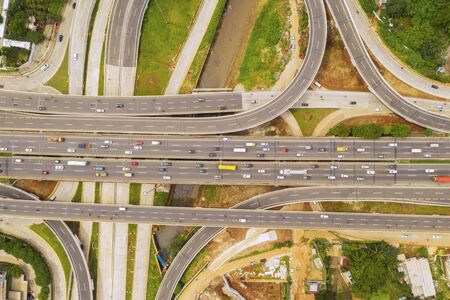 Top down aerial view of vehicles on Jakarta Outer Ring Road Toll and Depok Antasari toll road interchange 写真素材 - 132390754