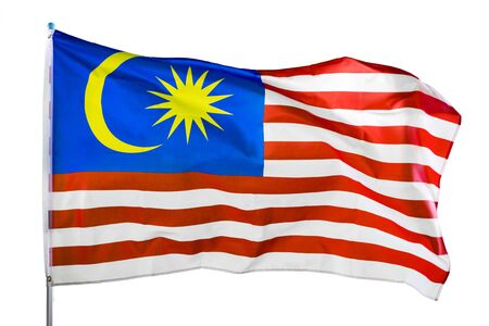 Close up of Malaysia flag waving in the wind on a flagpole, isolated on white background