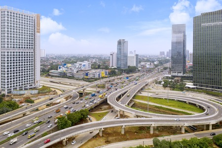 JAKARTA - Indonesia. October 14, 2019: Aerial view of Depok Antasari toll road interchange and Jakarta Outer Ring Road Toll with modern skyscraper