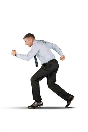 Side view of Caucasian businessman running in the studio, isolated on white background