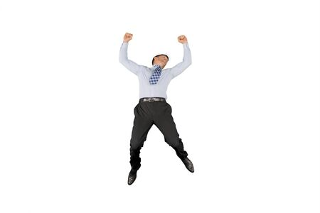 Caucasian businessman looks happy while jumping with arms raised, isolated on white background