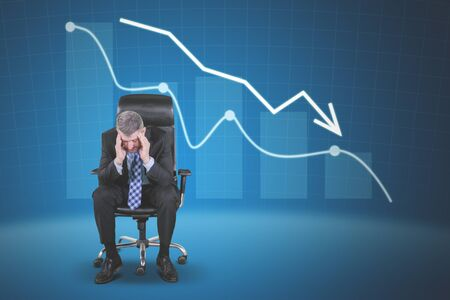 Portrait of caucasian businessman holding head in hands while sitting near downfall finance graph, shot on the blue Stock fotó