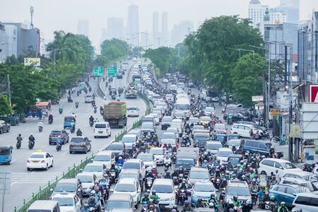 JAKARTA - Indonesia. August 27, 2019: Aerial view of traffic jam with crowded vehicles in Jakarta city Standard-Bild