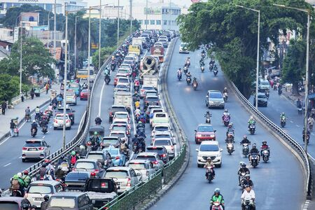 JAKARTA - Indonesia. August 27, 2019: Aerial view of traffic jam with crowded vehicles in one of the biggest viaduct in Jakarta city Standard-Bild