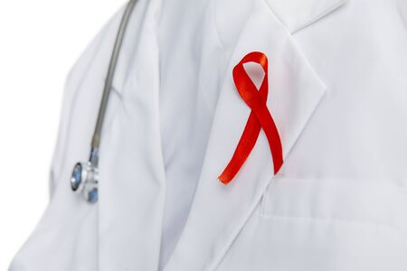 Closeup of a red ribbon on lab coats collar with a stethoscope hanging, isolated in white background Zdjęcie Seryjne